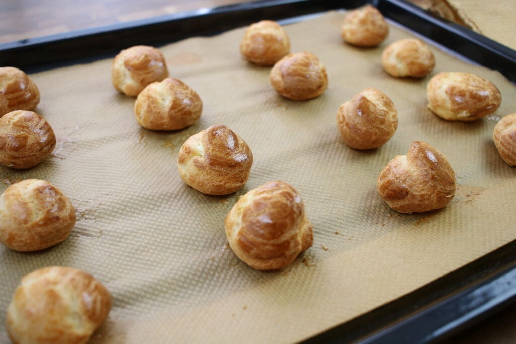 Just out of the oven Cream Puffs ready to fill with vanilla and chocolate custard
