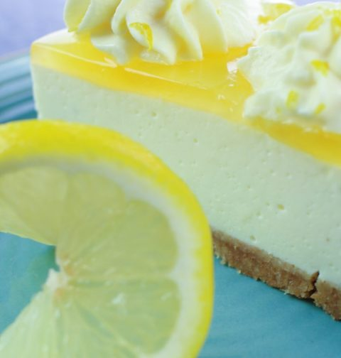 A slice of lemon no-bake cheese cake with lemon garnish