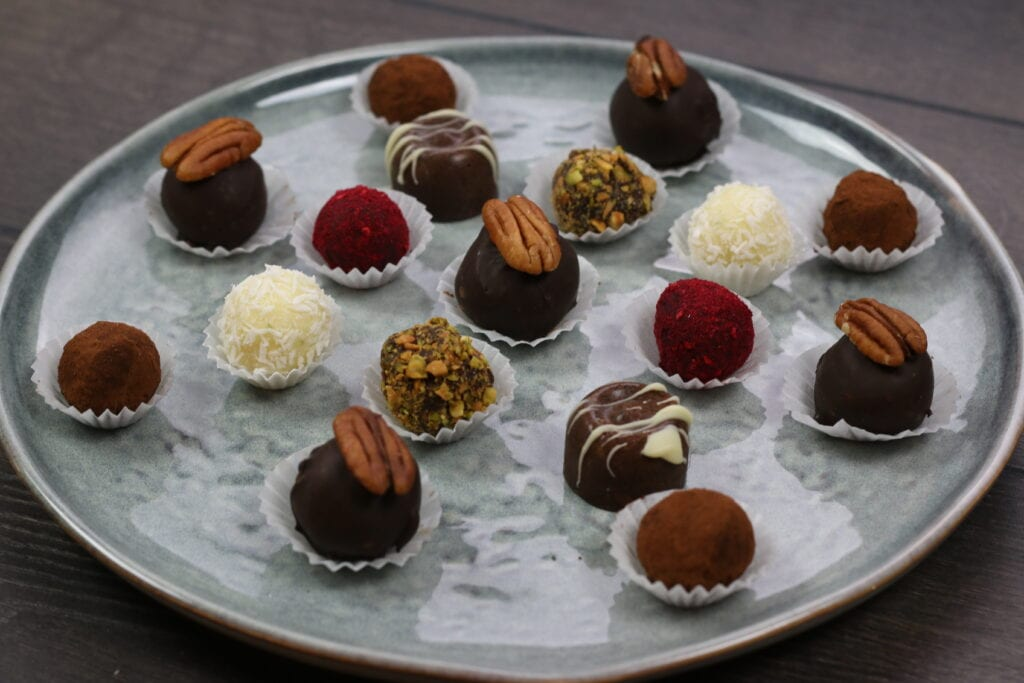 Homemade chocolate truffles in a variety of shapes and flavors