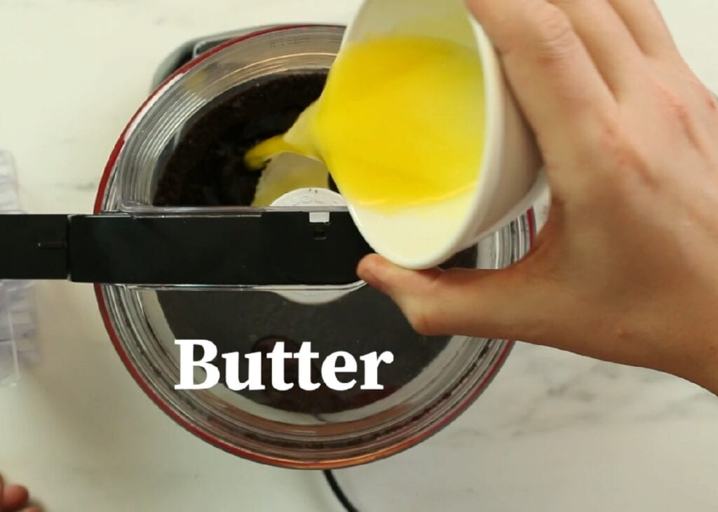 Mixing in the melted butter with the Oreo cookie crumbs.