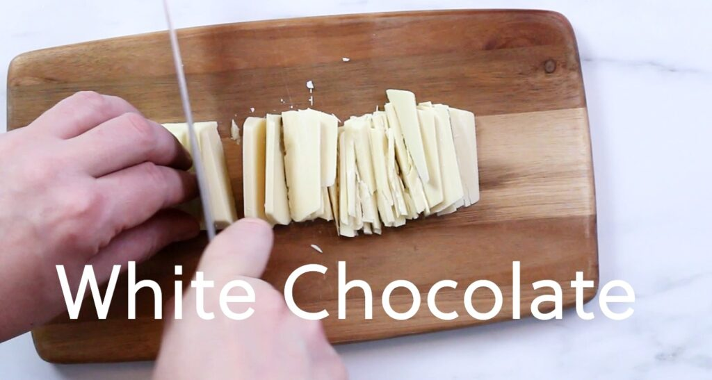 chopping white chocolate with a knife