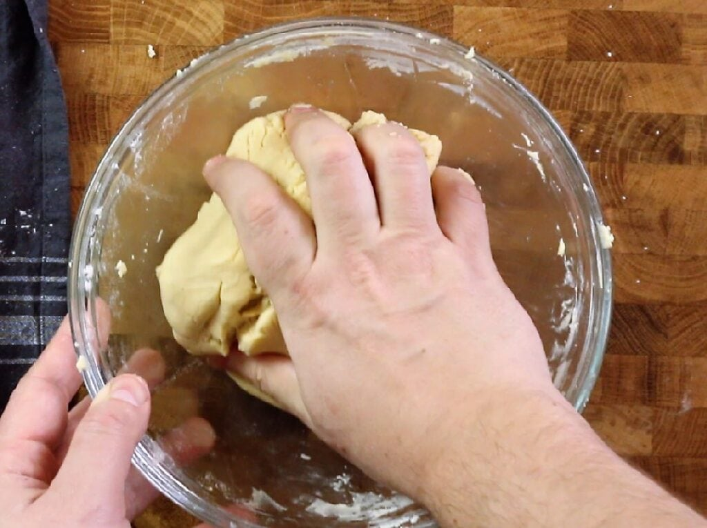 Working the dough by hand. Eggless, vanilla-flavored cookies dough
