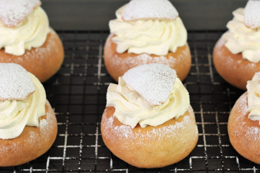 Semlor on a rack, the typical Scandinavian pastry