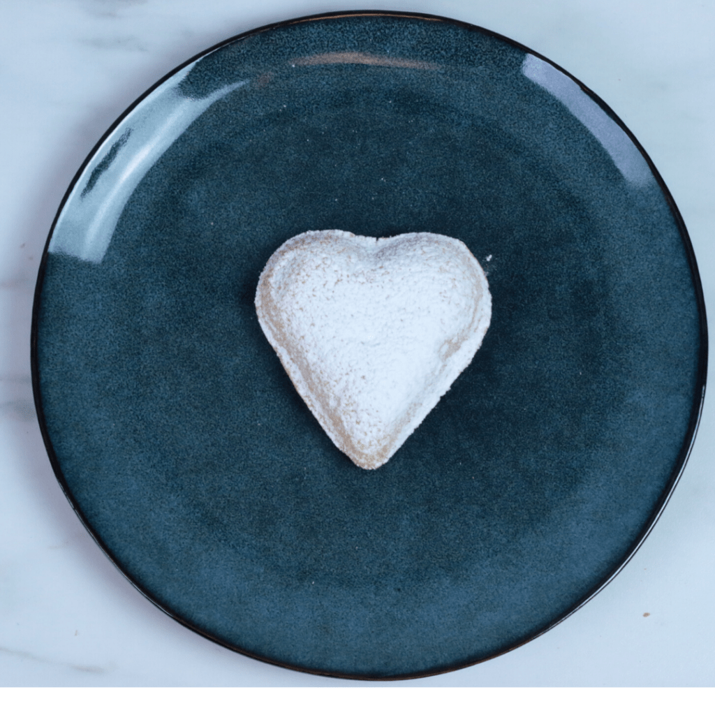 Heart shaped cookie on a blue plate