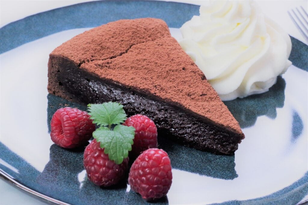 chocolate cake with fresh berries and whipped cream