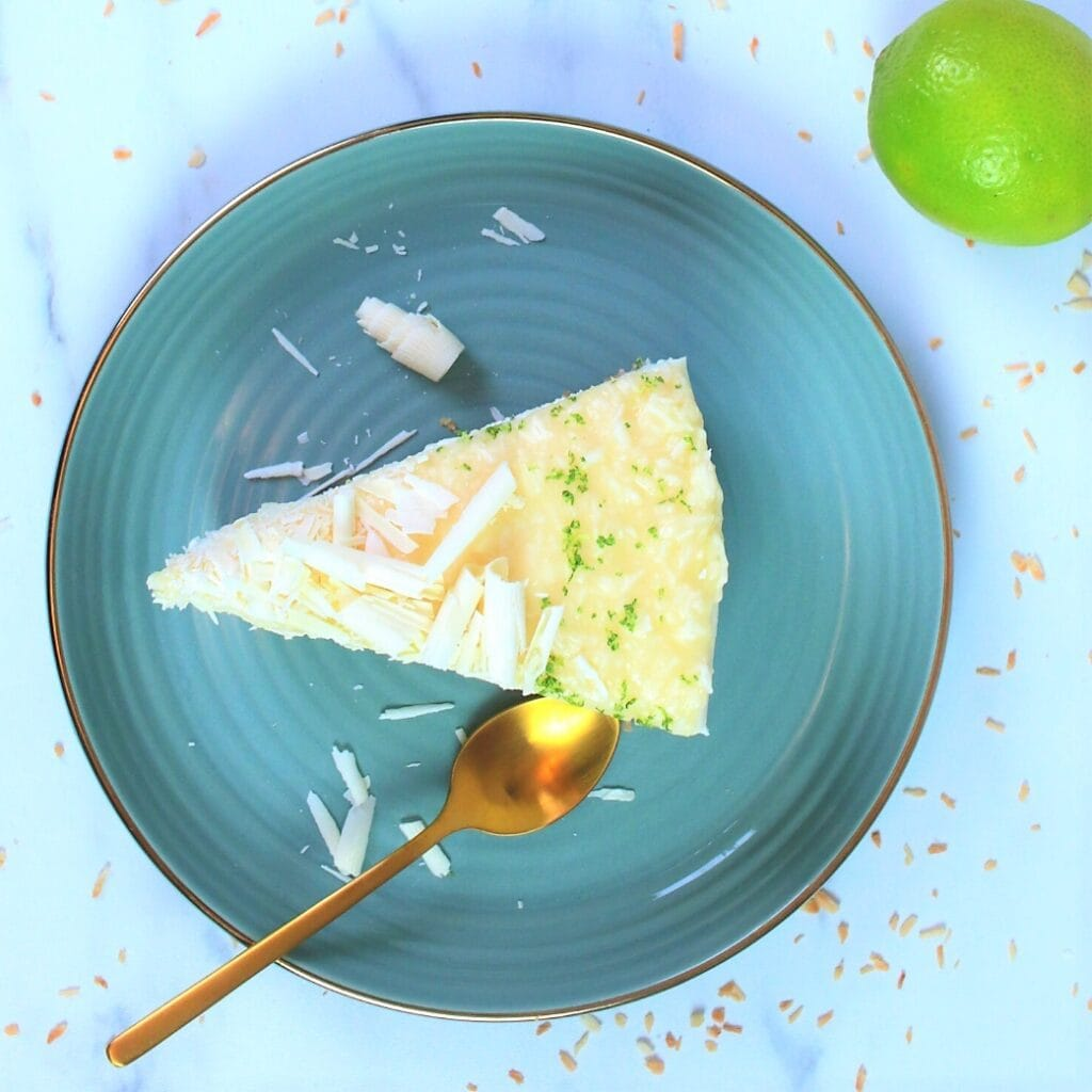 a sliceof  White Chocolate Coconut Cheesecake on a blue plate