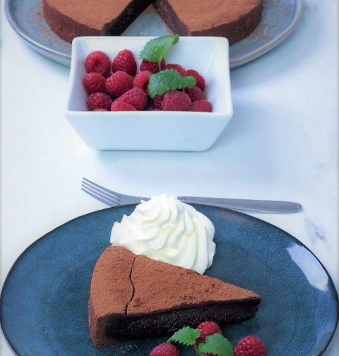 kladdkaka with whipped cream and fresh raspberry's