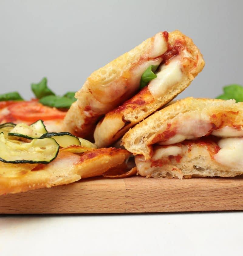 Slices of pizza al taglio on a cutting board