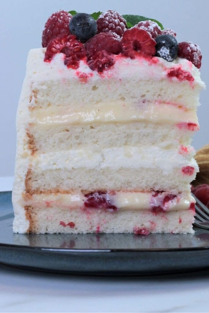 sponge cake layered with pastry cream and fresh fruits